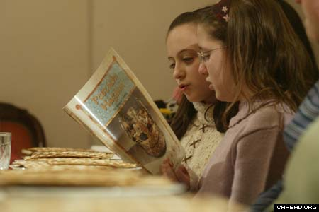 Children read along in their native Magyar during a model Passover Seder hosted by Chabad-Lubavitch of Budapest. The Chabad House has published tens of books in the Hungarian language, including the Haggadah – or order of service for the Seder – thereby making Jewish traditions much more meaningful for the local population.