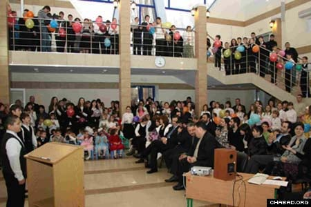 Children from the new Ohr Avner Chabad Day School in Krivoy Rog, Ukraine, perform for guests at the institution's grand opening ceremony.