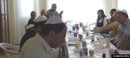 Jewish residents and tourists in Northern Cyprus enjoy a community meal organized by Rabbi Chaim Hillel and Devorah Leah Azimov.