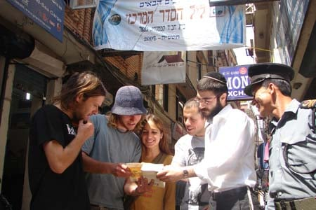In Nepal, Israeli tourists confer with a Chabad-Lubavitch rabbinical student, one of hundreds who traveled across the globe to lead Passover Seders in cities not served by full-time rabbis or emissaries.