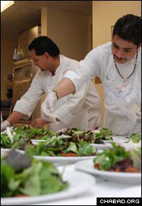 Assistants of chef Linda Bergh put the final touches on salads for the 10th anniversary dinner of the Chabad Jewish Center in S. Fe, N.M.