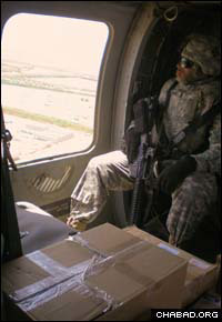 Passover provisions from the Aleph Institute fly to Baghdad aboard a military helicopter.