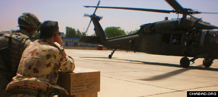 Soldiers in Iraq prepare to load a helicopter with Passover supplies.