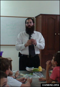 Rabbi Shimon Pelman, co-director of the just-established Chabad-Lubavitch of the Dominican Republic, teaches a class to children of the local Jewish community.