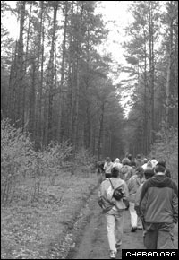 March of the Living participants from Atlanta walk through the forest outside Tykocin, Poland, where 2,000 Jewish men, women and children were shot to death.