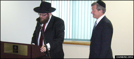 Rabbi Chaim Bruk, left, co-director of Chabad-Lubavitch of Montana, confers a blessing on the state's senior U.S. senator, Max Baucus.