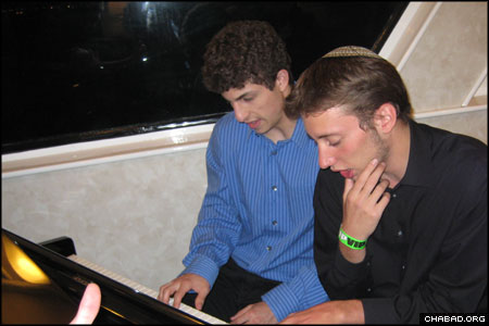 "Jewish college students riding the first-ever ""Jews Cruise"" pick out a few notes on the keyboard during Lag B'Omer festivities sponsored by the Chabad Jewish Center at the University of Southern California, the Chabad student group at S. Monica College, and the Chabad Houses serving the University of California at Los Angeles and California State University, Northridge."