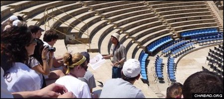 Participants of a Mayanot-provided Taglit-birthright israel trip visit the remains of the Roman amphitheater in Caesarea, Israel.