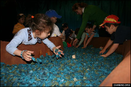 """In the """"Sinai Sensation"""" at the Jewish Children's Museum, a project of the Chabad-Lubavitch children's organization Tzivos Hashem, visitors played archaeologists by digging through a mock seabed to find treasures left behind during the biblical splitting of the Sea of Reeds."""