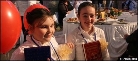 Two proud bat mitzvah girls take a break during a grand banquet at S. Petersburg, Russia's famed Great Choral Synagogue.