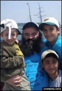 Chabad-Lubavitch Rabbi Dan Rodkin, center, co-director of Brighton, Mass.'s Shaloh House and Camp Gan Israel, decided to expand an effort to bring children from Sderot, Israel, to Jewish summer camps in North America and Europe.