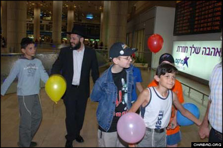 The arrival of Children of Chernobyl's 81st group in Israel was marked by dancing through Ben Gurion International Airport. The program, directed by Chabad-Lubavitch Rabbi Yossie Raichik, provides children with living quarters in a dormitory in the village of Kfar Chabad, as well as medical treatment and schooling.