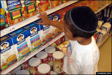 A camper from Camp Gan Israel of Birmingham, Ala., peruses the hot breakfast aisle of a local supermarket on the lookout for kosher labels. The July 11 scavenger hunt was one of dozens of activities the Lubavitch-run day camp has on its summer agenda, including a visit to an area cavern and a karate program.