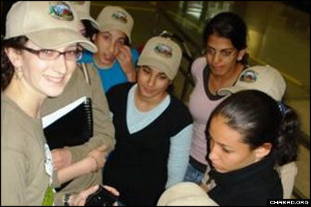 A counselor, left, with Camp Gan Israel of Running Springs, Calif., meets her new campers from Sderot, Israel, at Los Angeles International Airport.