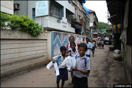 School children run outside the Chabad House in the Colaba Market area of Bombay, India. Rabbis Eli Marcus and Menachem M. Gansbourg arrived in the country July 16 as part of the Roving Rabbis program. All told, hundreds of rabbinical students are visiting Jewish communities around the world that are not served by full-time Chabad-Lubavitch centers.