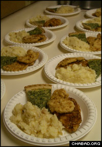 Plates of kosher entrees prepared by Grand Canyon Kosher Catering await packaging for a visiting group from Israel.