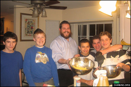 "The members of Chabad's Boys Teen Club in Goshen, N.Y., gather at Chabad-Lubavitch of Orange County every week. In addition, they sometimes bake at Rabbi Pesach Burston's home. ""I really look forward to Monday afternoons,"" said Lee Stanton, 13. ""Being with the guys, having the rabbi teach us new subjects of Judaism, and doing fun things has been really great."""