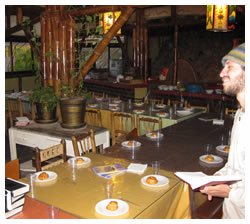 A tourist prays near the Shabbat tables before the onset of Shabbat.