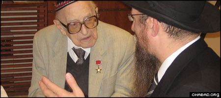 Boris Efimov, left, chats with Chief Rabbi of Russia Berel Lazar in 2007.