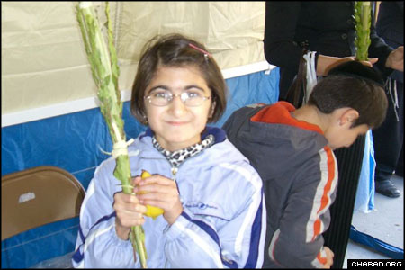 At the Bukharian Jewish Community Center in Queens, more than 400 children got to hold the Four Species in a sukkah outside before venturing indoors for a grand rally sponsored by the National Committee for the Furtherance of Jewish Education, which provides Jewish programming for public school students.