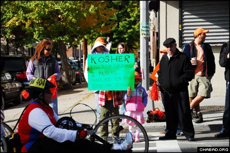 The race began early Sunday morning. Volunteers with Chabad-Lubavitch of Long Island City set up signs advertising the free refreshments.
