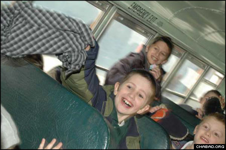 Sons of Chabad-Lubavitch emissaries enjoy a bus ride to a New York ice skating rink. The children took part in a sleepaway camp program while their fathers attended sessions at the 25th-annual International Conference of Chabad-Lubavitch Emissaries.