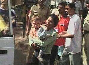Sandra Samuel escaping from the Mumbai Chabad House with 2-year-old Moshe'le Holtzberg in her arms