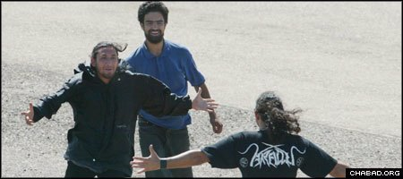 Orpaz Ohayon, center, and his friend Benny run to a family member after their release by Colombian guerrillas.