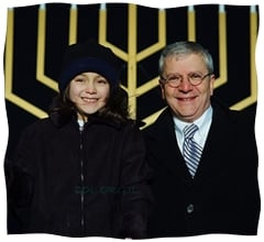 Chaya Sherman standing next to White House Chief of Staff Joshua B. Bolten at the National Menorah Lighting.