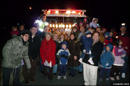 Hundreds of people gathered at each of the three stops on the parade route, taking the opportunity to pose in front of the menorah-covered Rescue Engine No. 3.