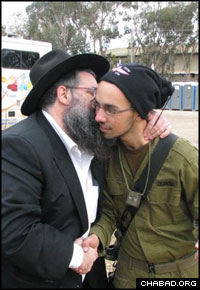 Chabad-Lubavitch Rabbi Moshe Ze'ev Pizem blesses an Israeli soldier prior to his deployment to the Gaza Strip.