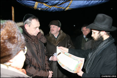 Chabad-Lubavitch Rabbi Levi Mondshine, chief rabbi of Smolensk, Russia, reads the marriage contract of one of two couples whose ceremonies were the first kosher Jewish weddings to be witnessed in the southwest city in 80 years.