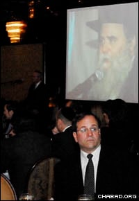 Attendees at the dinner listen to remarks by Rabbi Moshe Kotlarsky, Levi's grandfather. (Photo: Yosef Lewis)