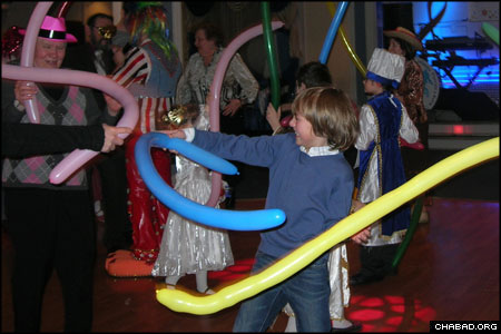 Jewish children in Smolensk, Russia, celebrate the holiday of Purim at a local restaurant. An interactive clown program entertained the crowd of all ages.