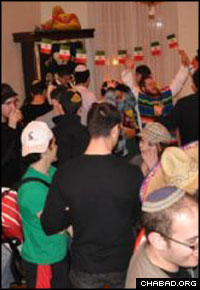 Students celebrate Purim with Rabbi Yudi and Rivky Steiner at the Lubavitch Center in Washington.
