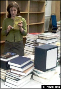 Chabad of Oxford co-director Freida Brackman sorts through the collections of the Samson Judaica Library.