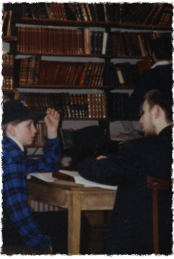 A rabbinical student learns Judaism with one of the local kids.