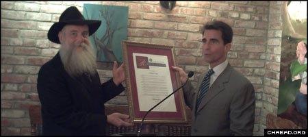 Rabbi Boruch Shlomo Cunin, left, receives a copy of a Chabad Day resolution from California state Sen. Mark Leno. (Photo: Michael Ross)