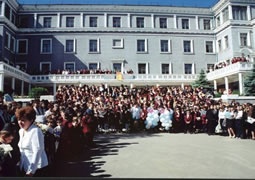 A group photo in the foreground of the Ohr Avner Levi Yitzchak Schneerson Day School