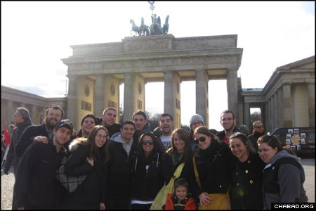 A delegation of students from the University of Illinois at Urbana-Champaign pose in front of Berlin's Brandenburg Gate with Rabbi Dovid Tiechtel, left, co-director of the Chabad Center for Jewish Student Life.