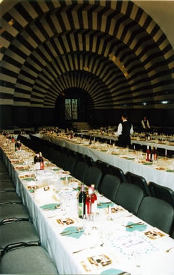 The Golden Rose Synagogue all set up for a public seder. (This picture is not fromn this past year. When I was there, the room was set up with many smaller round tables)