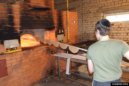 A baker puts hand-rolled matzahs in the oven at a bakery in Dnepropetrovsk, Ukraine.