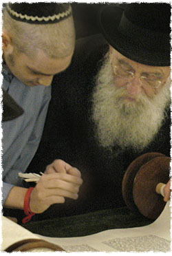Finishing the last letters of the Torah scroll that was started in my hospital room. (Photo: Clifford Lester)