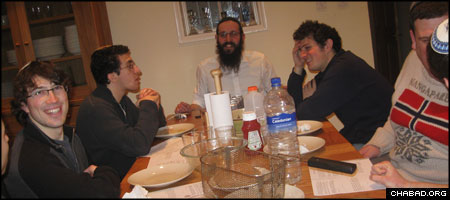 Rabbi Dovid Usiskin learns Torah with students at the new Chabad House serving Bristol University in the United Kingdom.