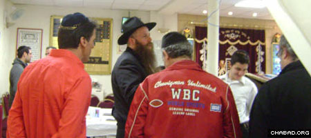 Community members gather at the Ohr Menachem Chabad House in S. Denis, France, in advance of Passover.