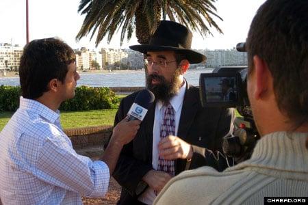 An Uruguayan National TV crew interviews Rabbi Eliezer Shemtov, director of Chabad-Lubavitch of Uruguay.