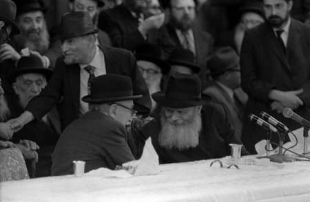 The Rebbe and Shazar converse during an interlude between the Rebbe's scholarly addresses. © 2009 JERRY DANTZIC ARCHIVES, All Rights Reserved