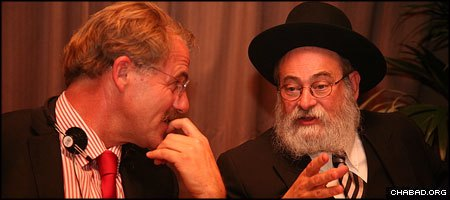 Chabad-Lubavitch Rabbi Binyamin Jacobs, right, chief rabbi of Holland, discusses Jewish prisoner issues with a fellow participant at this week's European Chaplains Conference.
