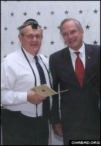 Mitch Wenzel, left, wore tefillin to a 2006 memorial ceremony for fallen CIA operatives presided over by the then-director of the agency Porter Goss.