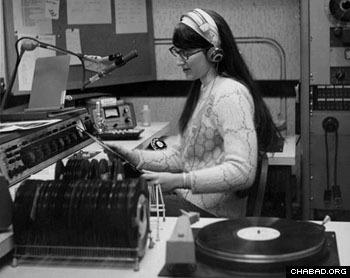 Donna L. Halper spinning records for WNEU (photo courtesy of Donna L. Halper)